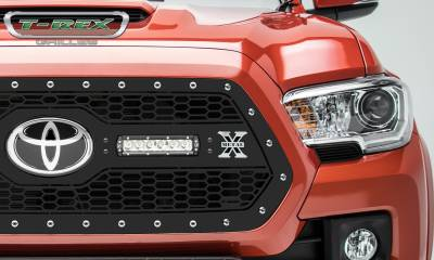 "T-REX GRILLES - 2018-2021 Tacoma Laser Torch Grille, Black, 1 Pc, Insert, Chrome Studs with (2) 6"" LEDs, Does Not Fit Vehicles with Camera - PN #7319511"