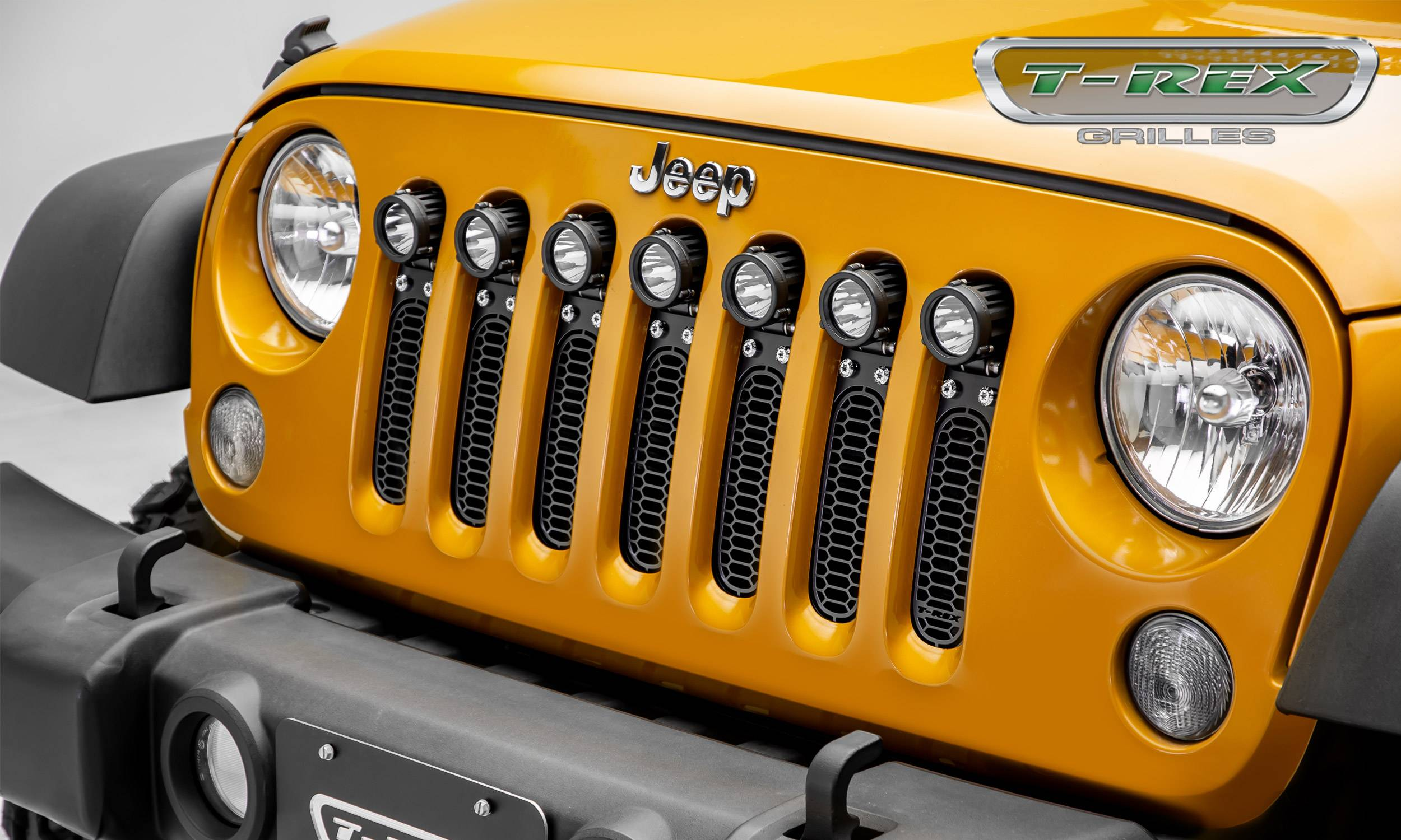 "T-REX GRILLES - 2007-2018 Jeep JK, JKU Laser Torch Grille, Black, 1 Pc, Insert, Chrome Studs, Incl. (7) 2"" LED Round Lights - PN #7314841"