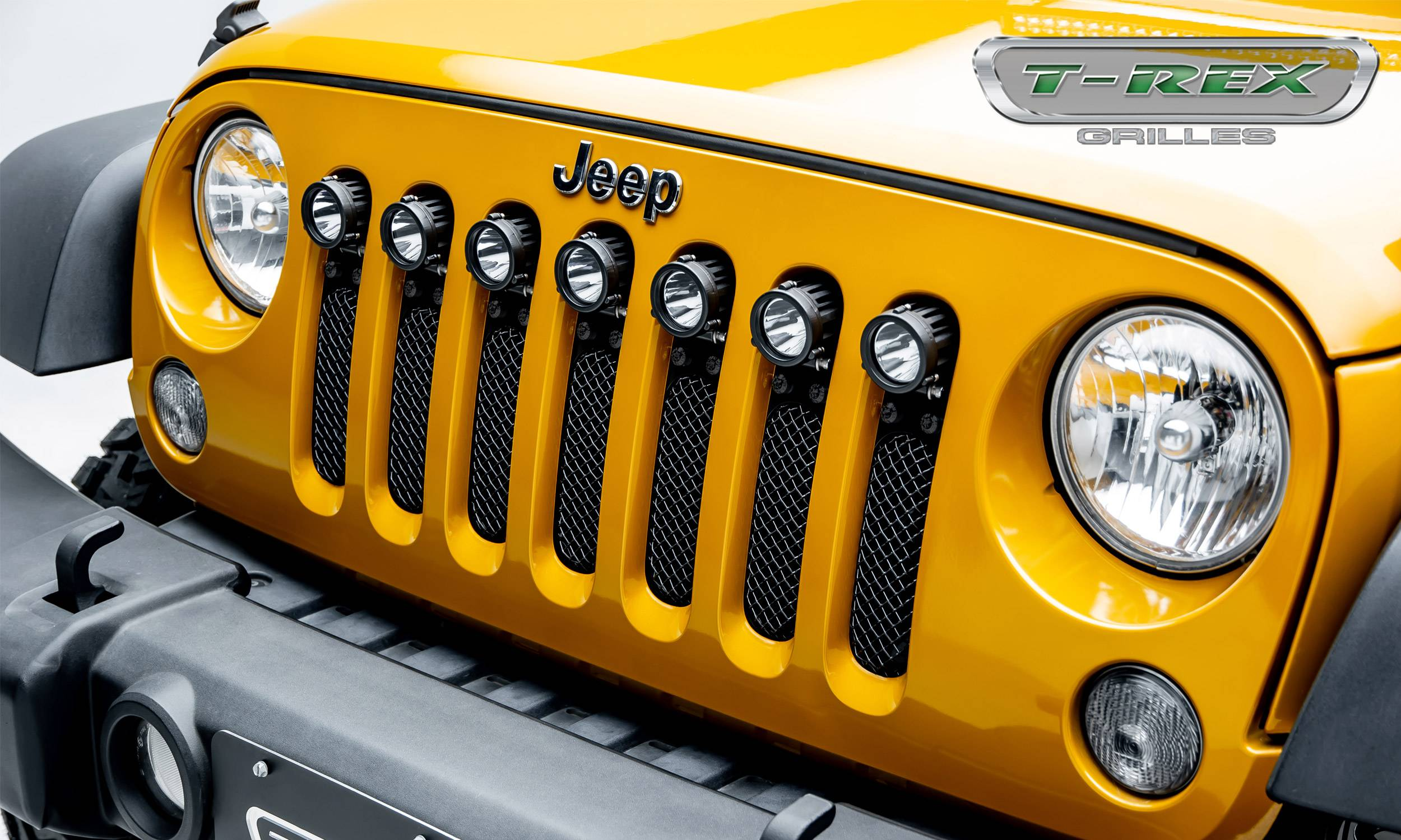 "T-REX GRILLES - 2007-2018 Jeep JK, JKU Stealth Torch Grille, Black, 1 Pc, Insert, Black Studs, Incl. (7) 2"" LED Round Lights - PN #6314841-BR"