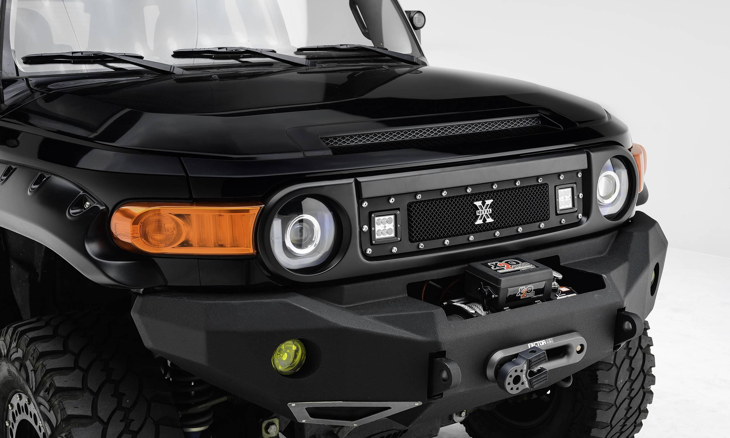 "T-REX GRILLES - 2007-2014 Toyota FJ Cruiser Torch Grille, Black, 1 Pc, Insert, Chrome Studs, Incl. (2) 3"" LED Cube Lights - PN #6319321"
