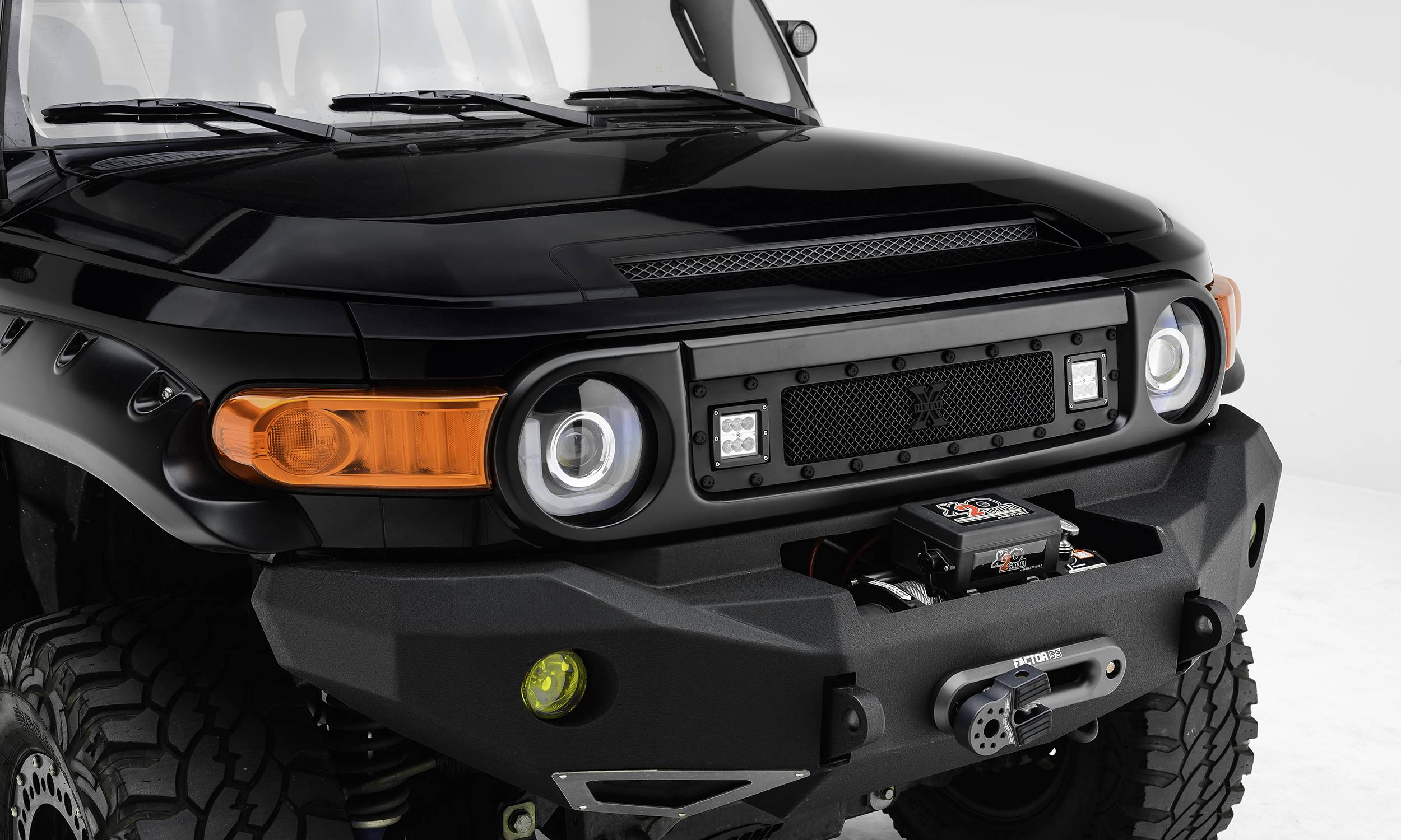 """T-REX GRILLES - 2007-2014 Toyota FJ Cruiser Stealth Torch Grille, Black, 1 Pc, Insert, Black Studs with (2) 3"""" LED Cube Lights - PN #6319321-BR"""